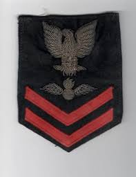 His rank Aviation Ordnance Man Second Class